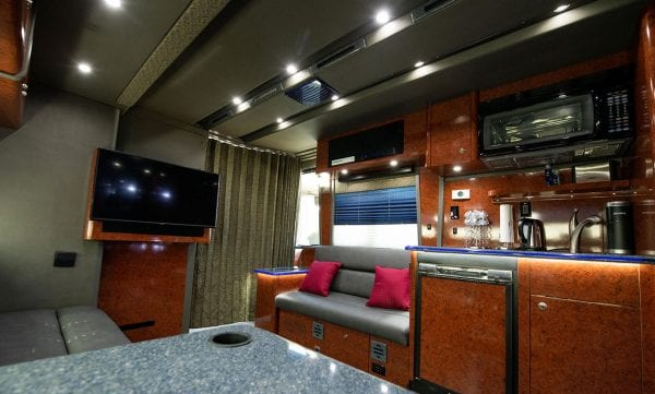 Galaxy tour bus front lounge