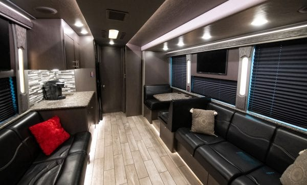 Entertainer tour bus front lounge